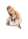 Little girl posing with book Royalty Free Stock Photo