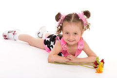 Little girl posing with a bouquet of flowers Royalty Free Stock Photos