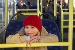 Little girl posing on the bus Stock Images