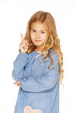 Little girl posing for the camera. In blue dress with blond curls Royalty Free Stock Photos