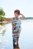 Little girl posing in fashionable overall Stock Photo