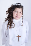 Little girl posing for the first communion Stock Photos
