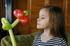 Little girl with balloons flower Royalty Free Stock Image