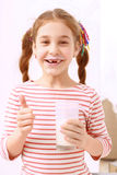 Little girl posing with glass of milk Royalty Free Stock Image