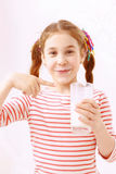 Little girl posing with glass of milk Stock Photography