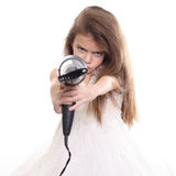Little girl posing with hair dryer Royalty Free Stock Photo