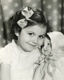 Little girl posing with her doll Royalty Free Stock Images