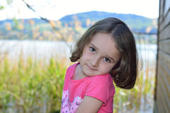 Little girl posing on a lake Royalty Free Stock Photography