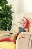 Little girl posing near the christmas tree Royalty Free Stock Images