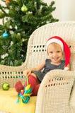 Little girl posing near the christmas tree Stock Photos