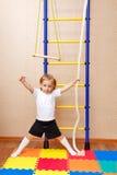 Little girl posing near wall bars Royalty Free Stock Photo