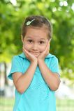 Little girl posing outdoors in summer Royalty Free Stock Images