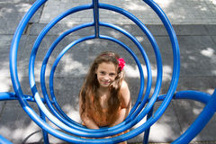 Little girl posing on the playground Stock Photo