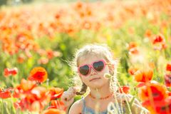 Little girl posing in a poppies Stock Photo