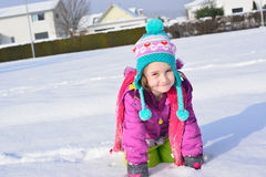 Little girl posing in the snow Stock Image