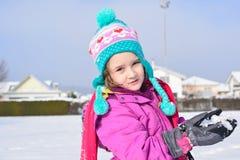 Little girl posing in the snow Stock Photos