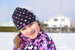 Little girl posing in the snow Stock Photography