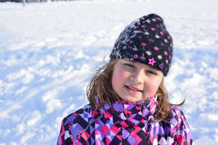 Little girl posing in the snow Royalty Free Stock Photography