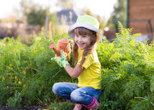 Little girl posing with watering can Royalty Free Stock Photography