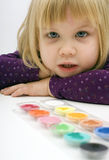 little girl, poster paints lie before her Royalty Free Stock Photos