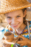 Little girl with pot Stock Photo