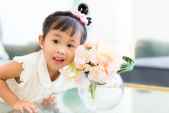 Little girl with potted flower Stock Photography
