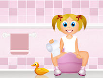 Little girl on the potty Stock Images
