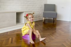 Little girl on the potty. In the room royalty free stock images