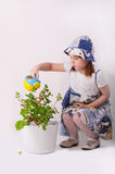 A little girl pours flowers Stock Images