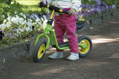 Little girl practicing cycling Royalty Free Stock Image