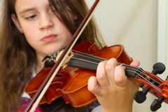 Little girl practicing her violin Royalty Free Stock Photo