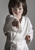 Little girl practicing karate Stock Image