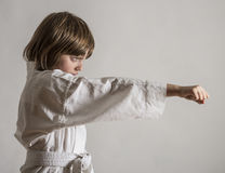 Little girl practicing karate Stock Images