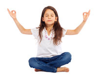 Little girl practicing yoga Stock Photo