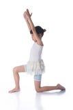 Little girl practicing yoga Stock Photos