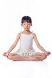 Little girl practicing yoga stock images
