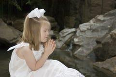 Little girl praying. Outside Royalty Free Stock Photo