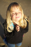 Little girl praying. A cute little girl with hands together in prayer Royalty Free Stock Photos