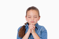 Little girl praying Stock Images