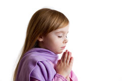 Little girl praying. A little girl with her eyes closed praying Royalty Free Stock Photos