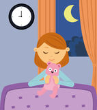 Little girl praying before bedtime. A little girl praying with her teddy bear before bedtime Royalty Free Stock Photography