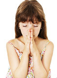 Little girl praying - closeup. Isolated on white background royalty free stock images