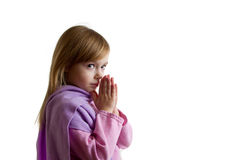 Little girl praying and looking Stock Photo