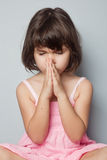 Little girl praying in lotus position Royalty Free Stock Photography