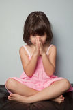 Little girl praying in lotus position. The little girl praying in lotus position Royalty Free Stock Photos