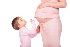 Little girl and pregnant stock image