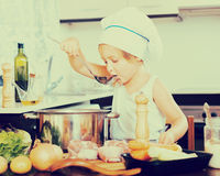 Little girl prepared soup with vegetables Royalty Free Stock Photo
