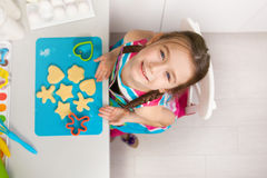 Free Little Girl Preparing A Cookie On Kitchen. Stock Photo - 78184710