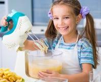 Little girl is preparing an apple pie Stock Image