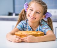 Little girl is preparing an apple pie Royalty Free Stock Images